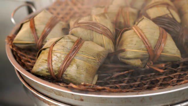 3 shots steamed abalone rice in lotus leaf in hong kong - bamboo plant stock videos and b-roll footage