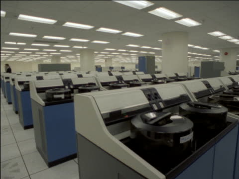 shots through bank of montreal's computer center tape library on some shots nobody is visible bank of montreal computer center on january 01 1982 in... - audio software stock videos & royalty-free footage