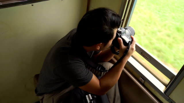 3 shots traveller man taking pictures at the train - photographer stock videos & royalty-free footage