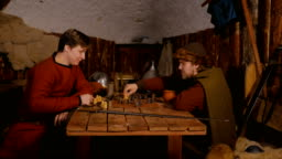 4 shots. Two men playing popular strategy board game - tafl