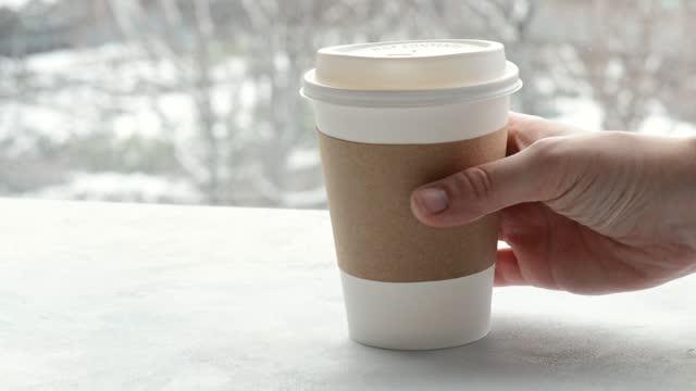 vídeos de stock e filmes b-roll de should you drink hot beverages in cold weather - utilização única