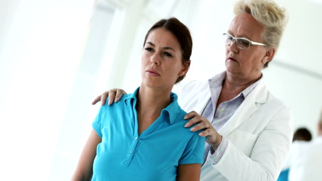 shoulder and neck pain medical exam - physical therapist stock videos & royalty-free footage
