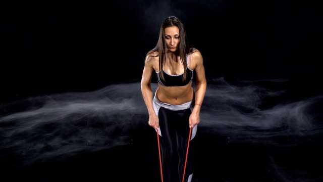 shoulder exercise with resistance band - bicep stock videos & royalty-free footage