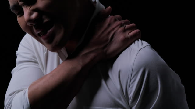 shoulder injuries, young man with pain in shoulder, ache in human body on black background.office syndrome, lifestyles, health care, medical, people concept.sick at home - illness stock videos & royalty-free footage