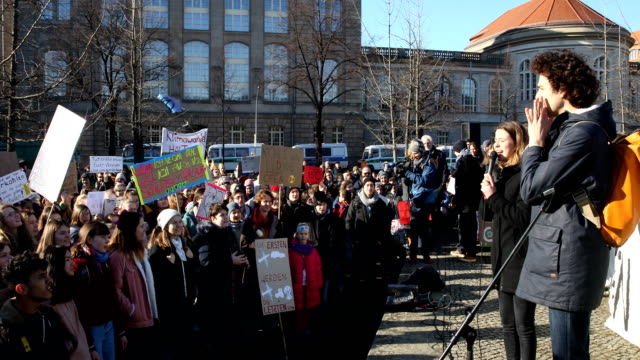 shouting and striking high school students march to protest for more effective government climate change policy on february 15, 2019 in berlin,... - voice stock videos & royalty-free footage
