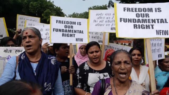 shouting slogans and holding banners against the lockdown in kashmir students and activists protest in new delhi as security tightened in kashmir on... - muharram stock videos & royalty-free footage