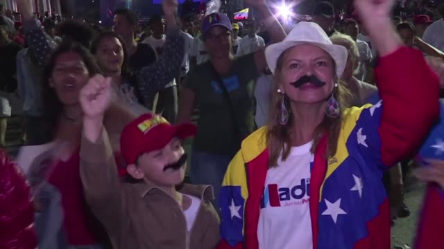 shouting slogans and wearing false moustaches supporters of nicolas maduro celebrate his reelection as president of venezuela after a vote boycotted... - maduro stock videos & royalty-free footage