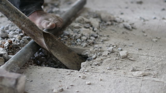 shovel spade destroyed concrete. - stone object stock videos & royalty-free footage