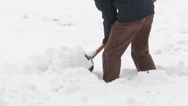 hd: shoveling snow - spade stock videos & royalty-free footage