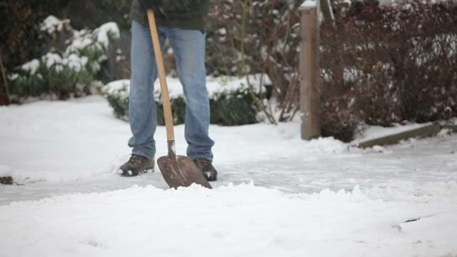 shoveling snow - pavement stock videos & royalty-free footage