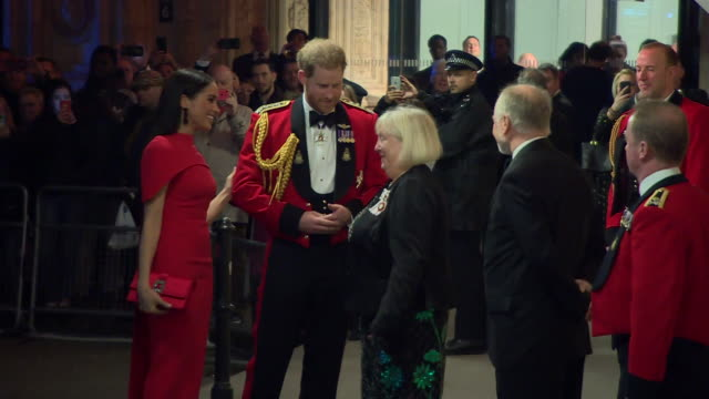 show exterior shots meghan duchess of sussex and prince harry duke of sussex arriving at the royal albert hall for the mountbatten festival of music... - meghan duchess of sussex stock videos & royalty-free footage
