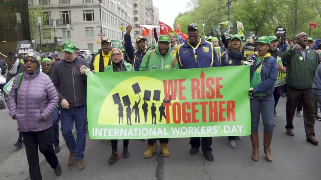 show here are members of local 372 – nyc board of education employees - afscme. new york city international workers day demonstrators gathered at... - 労働組合点の映像素材/bロール