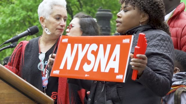 show here are members of new york state nurses association new york city international workers day demonstrators gathered at columbus circle 59th... - trade union stock videos & royalty-free footage