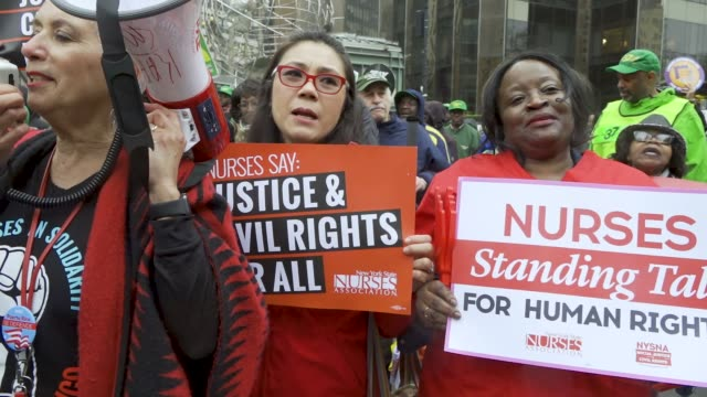 show here are members of new york state nurses association . new york city international workers day demonstrators gathered at columbus circle 59th... - 労働組合点の映像素材/bロール