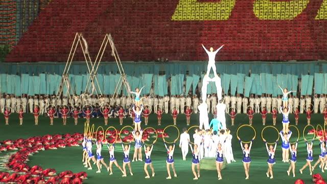 a show in a stadium in north korea - akrobat stock-videos und b-roll-filmmaterial
