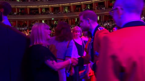stockvideo's en b-roll-footage met show interior shots meghan, duchess of sussex and prince harry duke of sussex meeting performers on stage at the royal albert hall for the... - royal albert hall