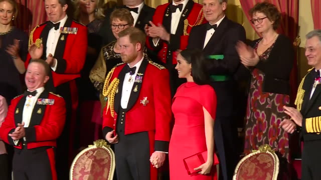 vídeos de stock, filmes e b-roll de show interior shots meghan duchess of sussex and prince harry duke of sussex walking to seats and singing the national anthem at the royal albert... - royal albert hall