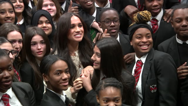 show interior shots meghan duchess of sussex posing with school children doing the each for equal sign to mark international women's day during a... - 国際女性デー点の映像素材/bロール
