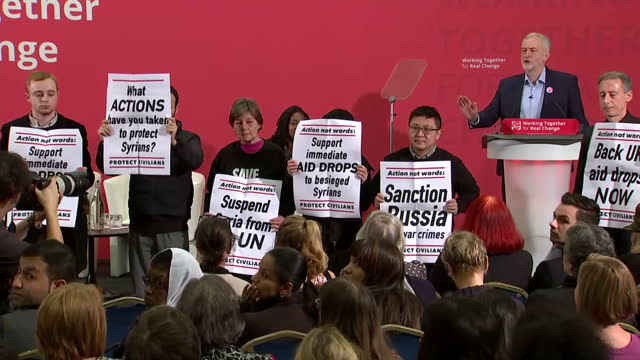 show interior shots uk labour leader jeremy corbyn interrupted as he gives speech by protesters including human rights campaigner peter tatchell... - human back stock videos & royalty-free footage