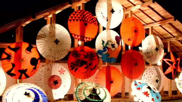 a show of washi paper parasols candles set in bamboo and dancing ladies with lanterns perched on their heads lit up historic yamaga kumamoto... - washi paper stock videos & royalty-free footage