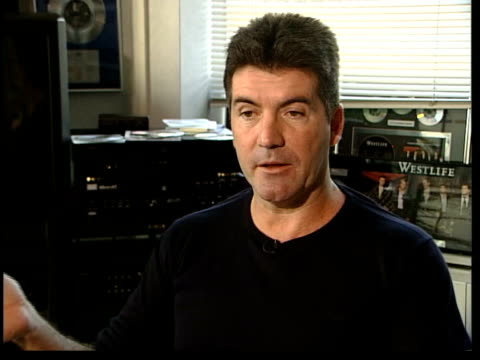 tv show pop idol criticised by mps itn simon cowell interview sot we've gone out of our way/ two girls in our top ten who don't conform/ i've... - 2003 bildbanksvideor och videomaterial från bakom kulisserna