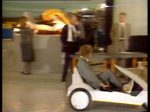 showcase for the sinclair c5 electric car, called the 'electric go-cart' / brief comments by inventor sir clive sinclair / director general of the... - alternative fuel vehicle stock videos & royalty-free footage