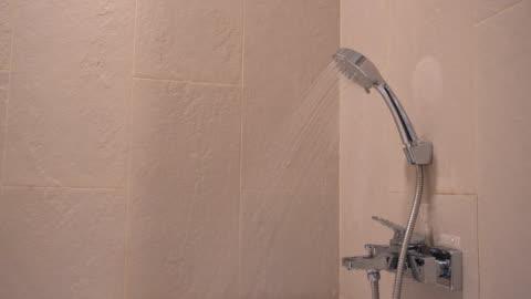 shower in bathroom - bathroom stock videos & royalty-free footage