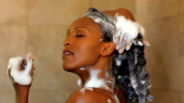 shower relaxing. - black hair stock videos & royalty-free footage