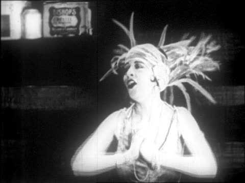 b/w 1916 showgirl in costume clutching hands in gratitude / feature - thank you点の映像素材/bロール