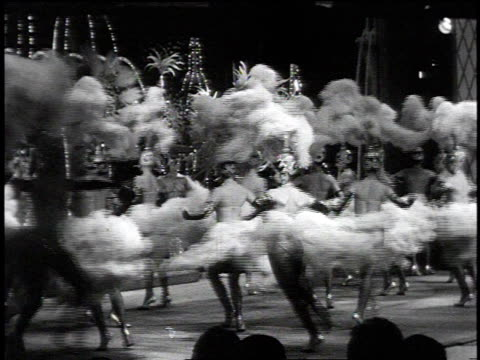1965 montage showgirls wearing feather headdresses performing at the tropicana / las vegas, nevada, united states - las vegas stock videos & royalty-free footage