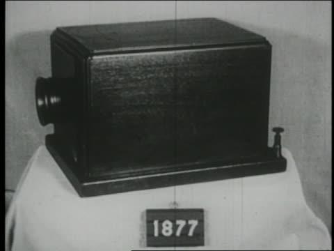 vídeos de stock, filmes e b-roll de b/w 1923 dissolve showing evolution of telephone - 1923