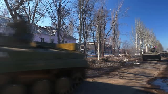 showing exterior shots separatists pro russian rebels on tanks passing camera in vuhlehirsk exterior shots buildings damaged by shelling mortar guns... - vox populi stock videos and b-roll footage