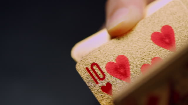 slo mo showing golden card in slow motion - poker card game stock videos & royalty-free footage