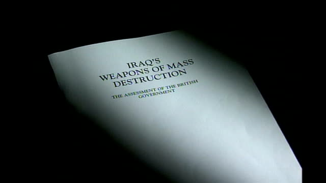 showing 'iraq's weapons of mass destruction' dossier - weapons of mass destruction stock videos & royalty-free footage