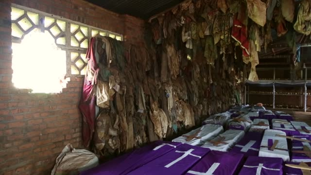 showing signs of extreme trauma victims' skeletal remains bloodstained clothing and possessions are displayed on metal racks and hanging from the... - völkermord stock-videos und b-roll-filmmaterial
