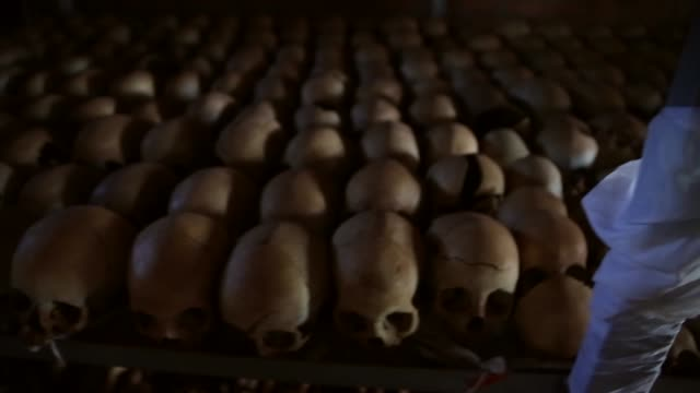 showing signs of extreme trauma victims' skeletal remains bloodstained clothing and possessions are displayed on metal racks and hanging from the... - genocide stock videos & royalty-free footage