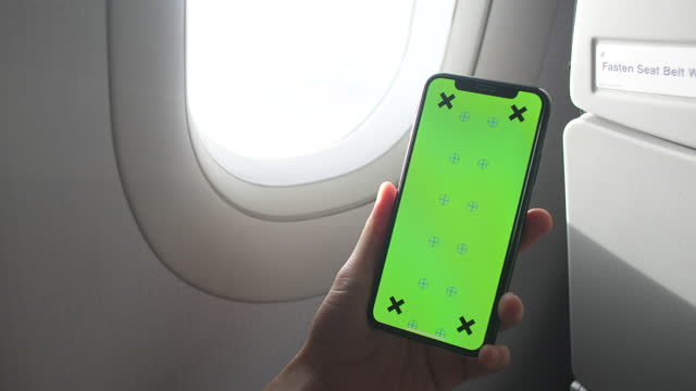 showing smart phone green screen during on board - information medium stock videos & royalty-free footage