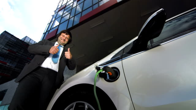 HD: Showing Thumbs Up While Charging Car