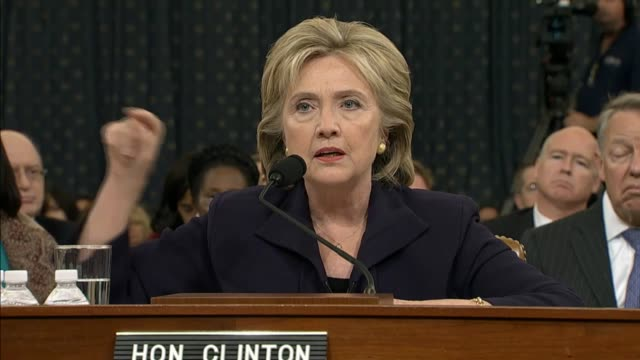 Shown a news video showing protests at the time of the Benghazi attack former Secretary of State Hillary Clinton explains difficulties she...