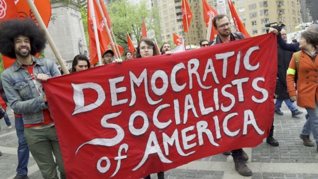 shown here are members of the democratic socialists of america new york city international workers day demonstrators gathered at columbus circle 59th... - 民主主義点の映像素材/bロール