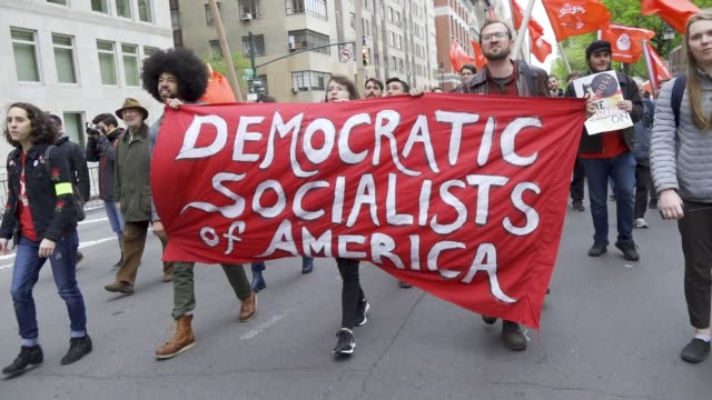 shown here are members of the democratic socialists of america. new york city international workers day demonstrators gathered at columbus circle... - socialism stock videos & royalty-free footage