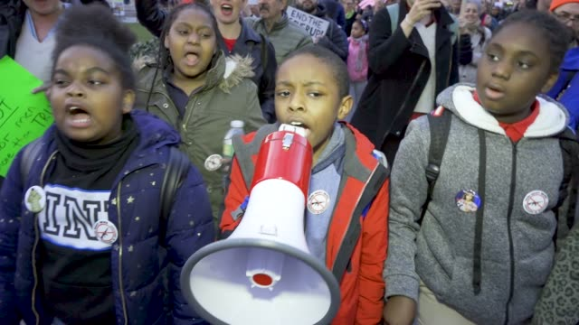 shown here are students from the achievement first brownsville charter elementary school. several hundred gathered at 42nd street times square for... - campaigner stock videos & royalty-free footage