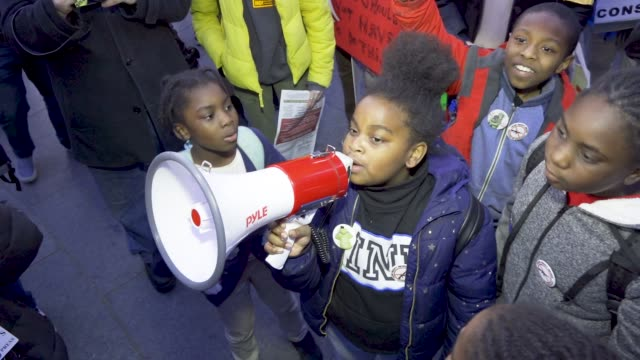 shown here are students from the achievement first brownsville charter elementary school. several hundred gathered at 42nd street times square for... - protestor stock videos & royalty-free footage