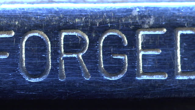 """forged in u.s.a"" shown in raised lettering on metal surface. - metallindustrie stock-videos und b-roll-filmmaterial"