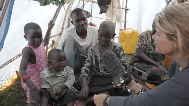 shows aerial drone shots tents and shelters in refugee camp near bunia exterior shots refugees in camp including many children exterior shots mynei... - head chopped off stock videos & royalty-free footage