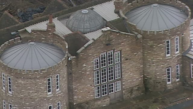 Shows Aerial exterior and interior shots of fake castle built by farmer Robert Fidler Robert Fidler leaving court after hearing and Soundbite A...