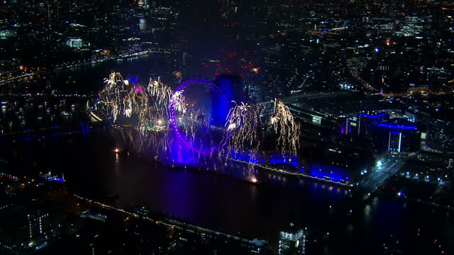 Shows aerial night shots Firework display on River Thames and The London Eye to welcome 2018 on 1st January 2018 in London England UK