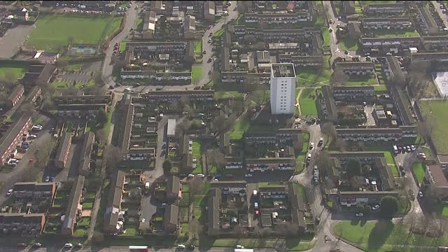 Shows aerial shots across rooftops of low level with few midlevel rise towers in Chelmsley Wood near Birmingham in the West Midlands on February 07...
