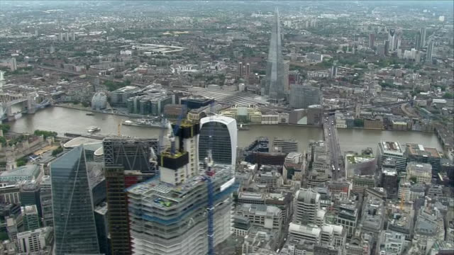 shows aerial shots across skyscrapers in city of london st paul's cathedral along the river thames on overcast day on 10th july 2018 in london england - thames river stock videos & royalty-free footage