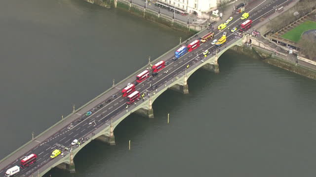 Shows aerial shots air ambulance in Parliament Square with pan across emergency services in roads around the Houses of Parliament and on Westminster...